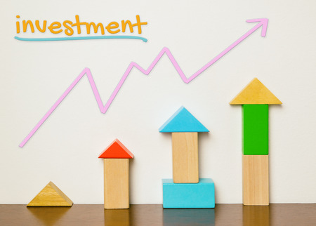 build up: Childish Investment concept in colorful toy build up. Investment is fun and colorful. Block toys building up as financial investment graph diagram. Learning investment is easy for beginner. Stock Photo