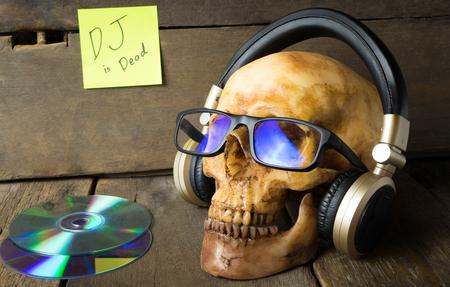 ghost rock: Music DJ is Dead. Ghost is listening to music headphone.