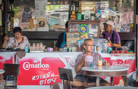 locals: Suphanburi, Thailand - October 24, 2015: Thai Locals are sitting in Thai Traditional Cafe.