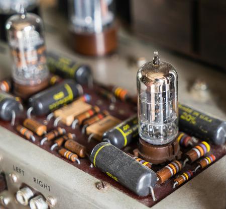 Electronics component on vintage tube vacuum amplifier radio.