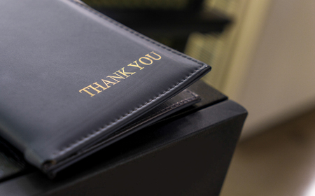 billing: Leather Credit card folder for customer billing. Payment tray for cafe and restaurant. Stock Photo