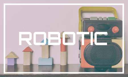 typo: Robotic typo with colorful toy in background Stock Photo
