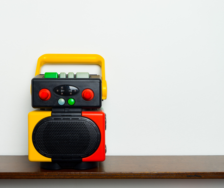 wooden shelf: Retro Colorful Robot Boom box music player on wooden shelf with copy space