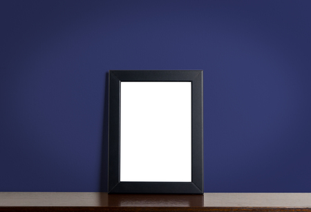 navy blue background: Black picture frame border on Navy classic background. Empty photo frame for your photo with dark blue wall.