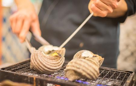 prepared shellfish: Japanese Chef Grilling Shelfish