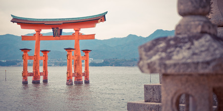 social history: Hiroshima, Japan - March 16, 2016: Miyajima floating Torii is the most famous tourist destination in Hiroshima.