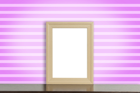 room accent: Blank Wooden photo frame on table with Pink stripe background. Stock Photo