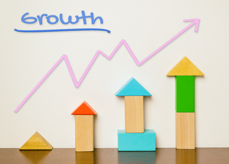 Colorful toy with rising graphic diagram for Growth concept.