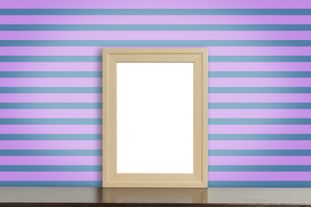room accent: blank Wooden photo frame on a funky purple strip background Stock Photo