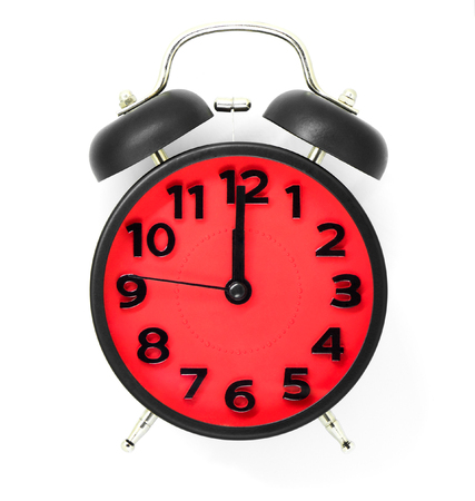 Red clock pointing at midday or midnight on white background.