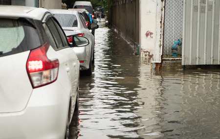 hydroplaning: Cars traveling in a flooded street of Bangkok