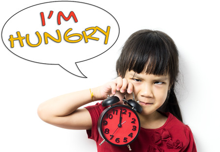 malnutrition: Funny Asian girl is requesting for Lunch Break saying she is hungry for food.
