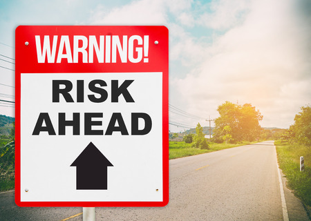 road ahead: Warning sign on the road ahead say Risk Ahead. Business and risk management concept.