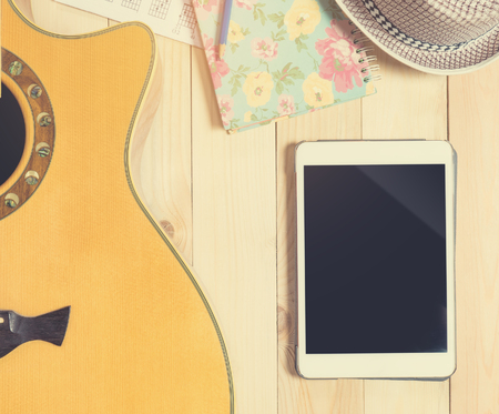 blank tablet: Blank tablet screen with music equipment.