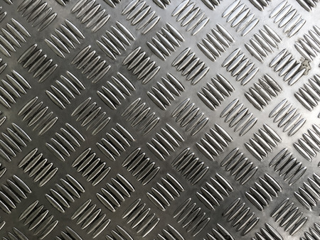 Metal plate floor tiles with anti slip texture.