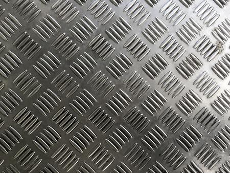 treadplate: Metal plate floor tiles with anti slip texture.