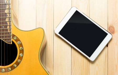 blank tablet: Guitar with Blank tablet screen for application and copy space.