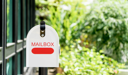 Home office red Metal Mailbox in garden Stock Photo