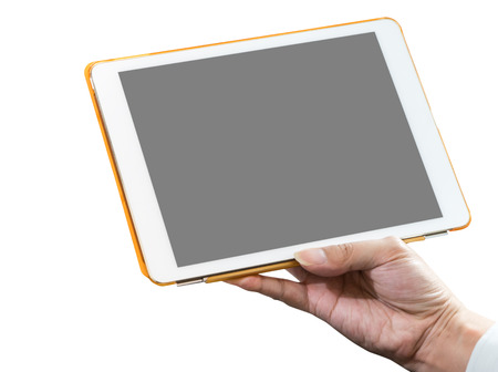 blank tablet: Business man hand holding a white tablet with blank screen. Stock Photo