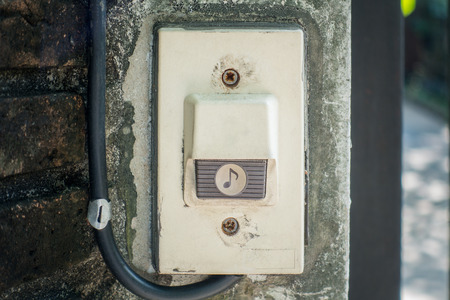buzzer: Electric House Gate Buzzer Bell button on concrete wall