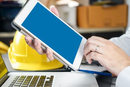 blank tablet: Blank Tablet Screen in Construction office industry.