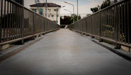 Pathway on concrete street crossing bridge Stock Photo
