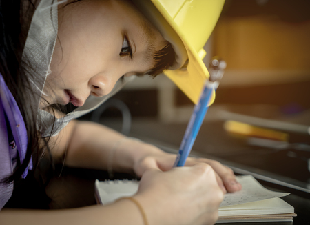 Girl Student studying for construction industry.