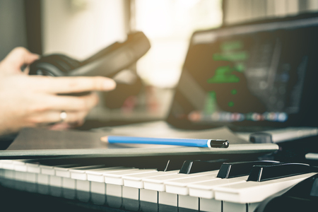 Musician prepare to writing his new song in studio