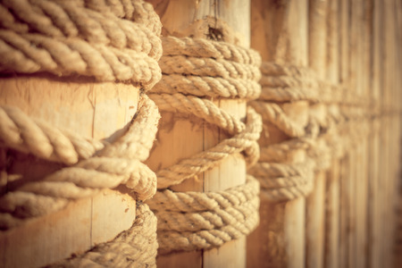 Bamboo wall made from tighten the rope Stock Photo