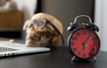 job deadline: Business man dead skull working overtime