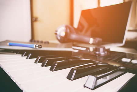 making music: Synth keyboard in a home music studio Stock Photo