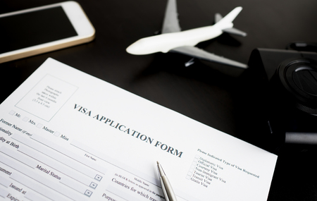 Filling travel Visa application form for vacation Stock Photo