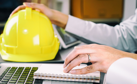 Construction engineer is reading instruction on his notebook Stock Photo