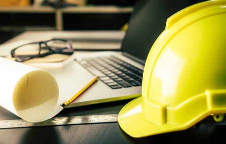 Engineer Architect working table with safety helmet