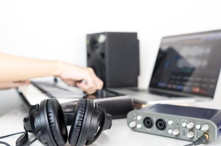 Musician is producing music on Music studio working desktop Stock Photo - 74014576