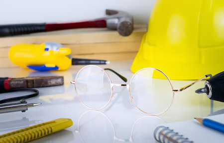 Engineer construction repair tools with eyeglass in the middle Stock Photo