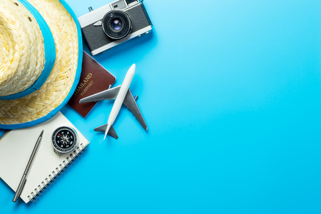 Summer travel blogger accesories on blue copy space