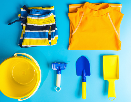 Boy Swiming suit and beach accesories flat lay for Summer vacation theme Archivio Fotografico