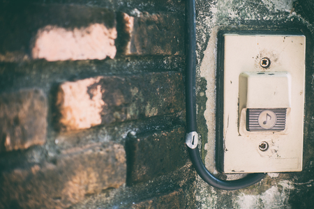 Rustic Front Gate Door Bell On Brick Wall Gate Stock Photo   75261397
