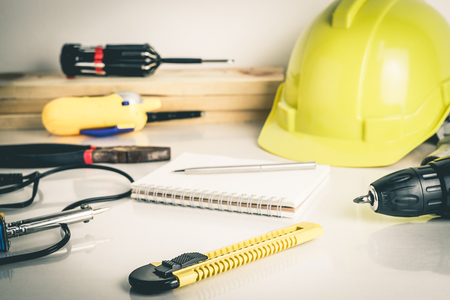 architect drawing: Construction worker repair tools on white desktop Stock Photo