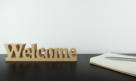 Welcome sign with notebook on office table with copy space Stock Photo - 76331173