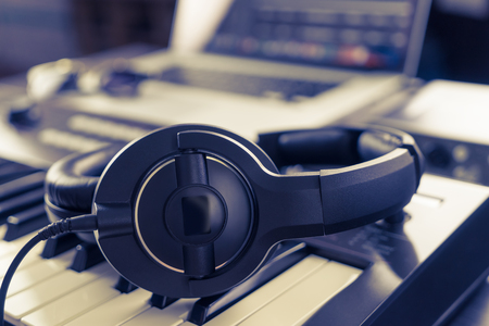 Black headphone on computer music home studio set up Stock Photo