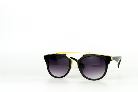 Gold vintage sunglasses stack focus islated on white Stock Photo