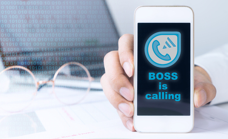 Boss is calling on office worker mobile phone Фото со стока