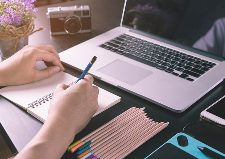 Photograph and graphic designer working desk with tools Stock Photo