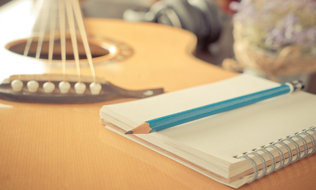 Guitar with Blank notebook for music songwriting