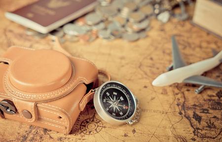 worl: Vintage travel explorer items on vintage map for worl explorer concept