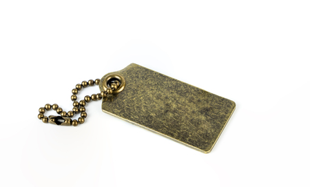 Empty Metal Gold Brass tag isolated on white background Stock Photo