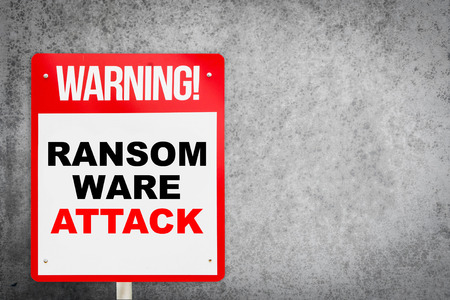 Ransomware Attack warning on concrete copy space