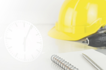 Construction time limitation concept with tools and wall clock